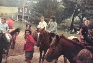 People sitting on horses