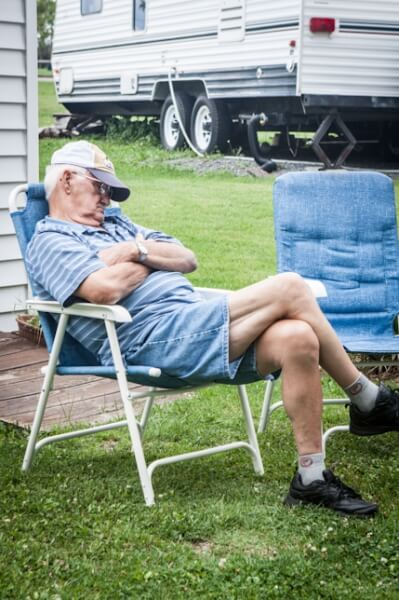 Man sleeping in camp chair