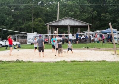 People playing volleyball on a sand volleyball court